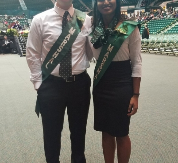 Ryan and Chelsea as Marshall's at Graduation